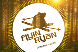 Flyin Ryan logo over backlit woods