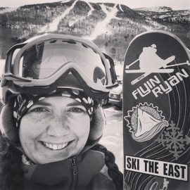 Megan Davin with Flyin Ryan decal on skis
