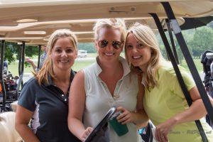3 women with golf cart