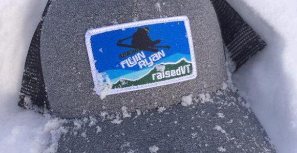 grey Flyin Ryan + raisedVT trucker hat